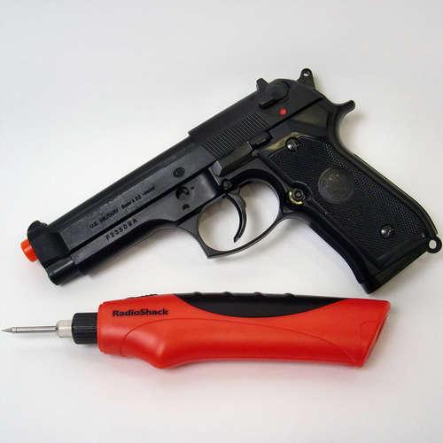 The HFC M9 Spring Airsoft Gun Pistol and RadioShack cordless soldering iron before being dismantled and merged into one