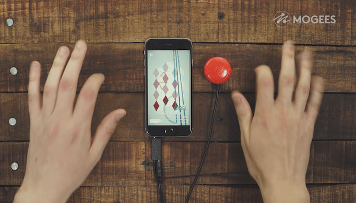 Mogees Play is a device that contains a contact microphone which records the vibrations as you tap surfaces, and transfers the signal into an app that lets you play games and make music
