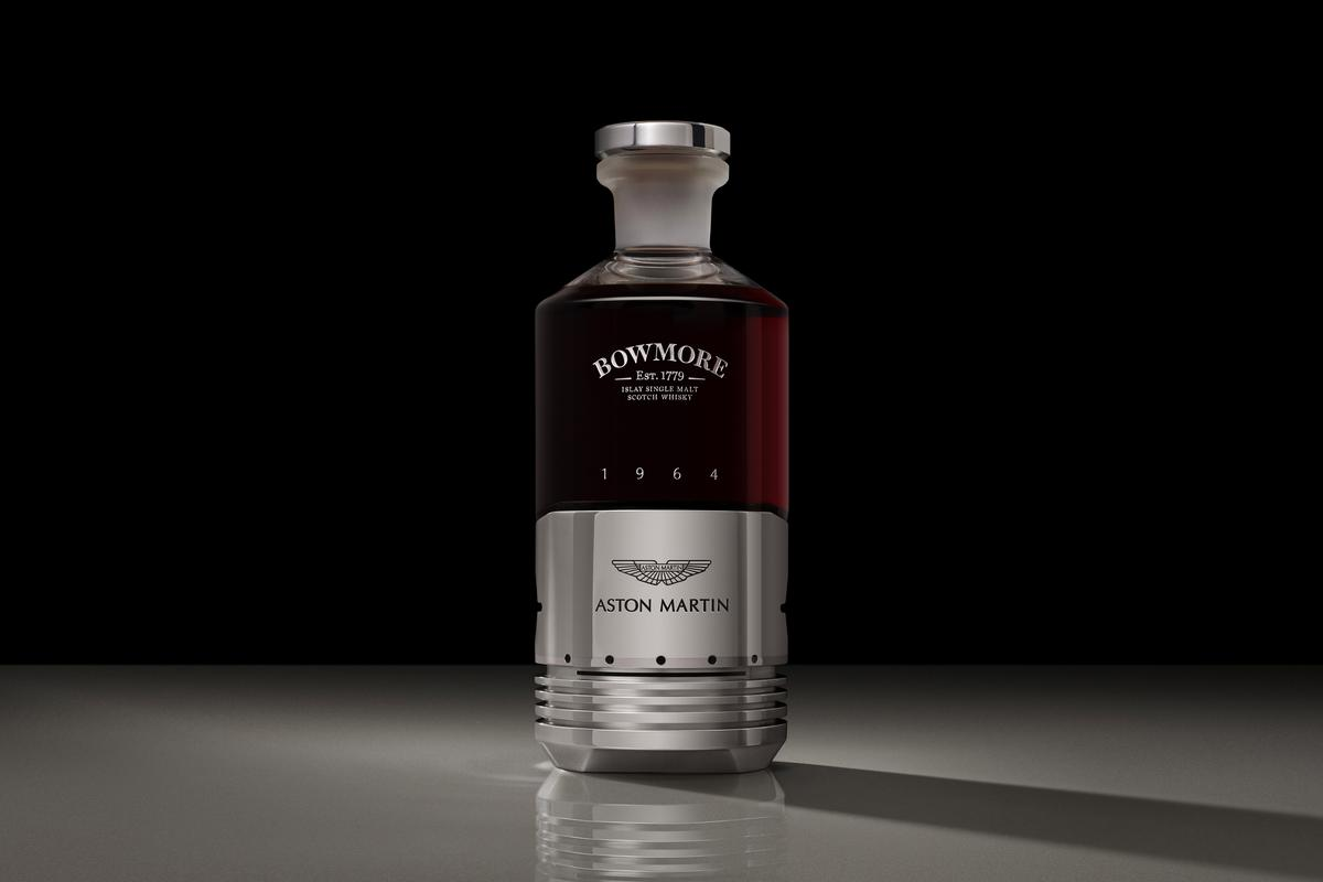 The iconic Bowmore whisky and the legendary Aston Martin DB5 are linked by the bottle of single malt whisky incorporating an Aston Martin DB5 piston