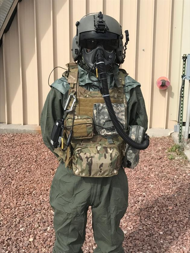 An Airman demonstrates the Joint Service Aircrew Mask - Rotary Wing mask