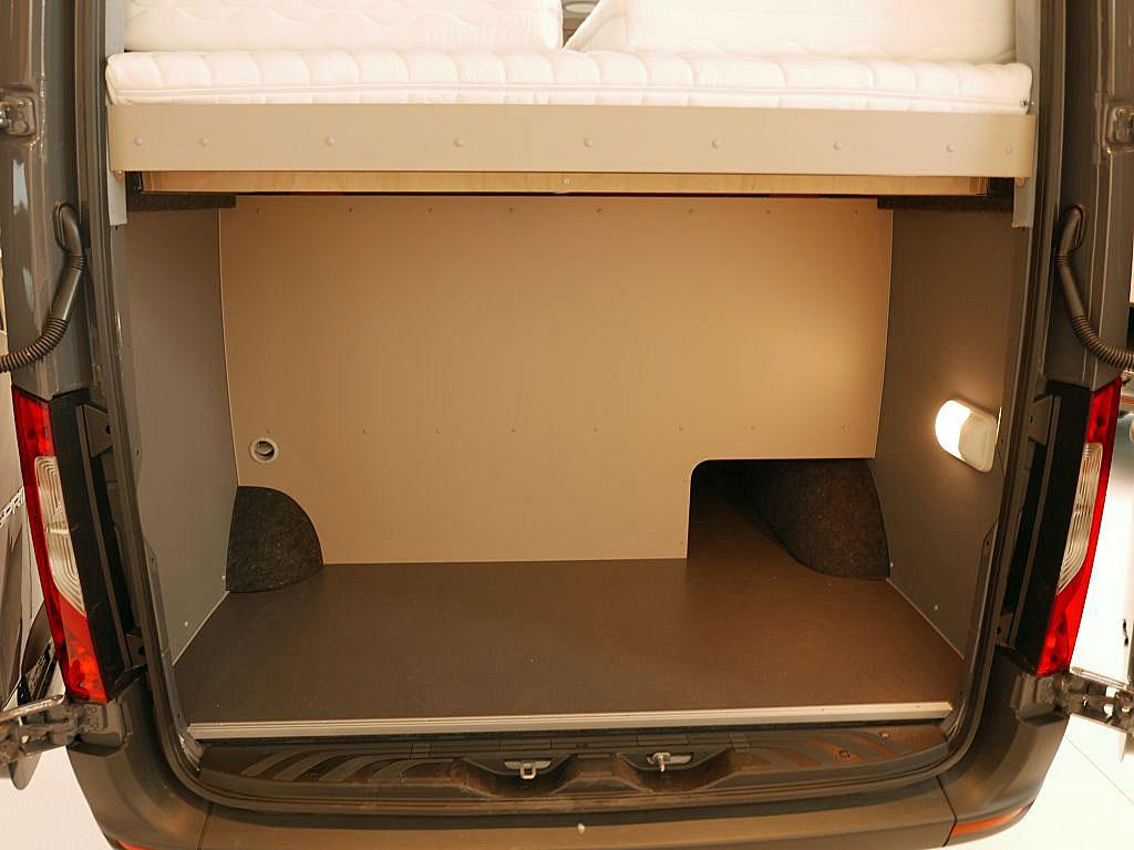 The rear load area includes a small passthrough for skis, poles and similar