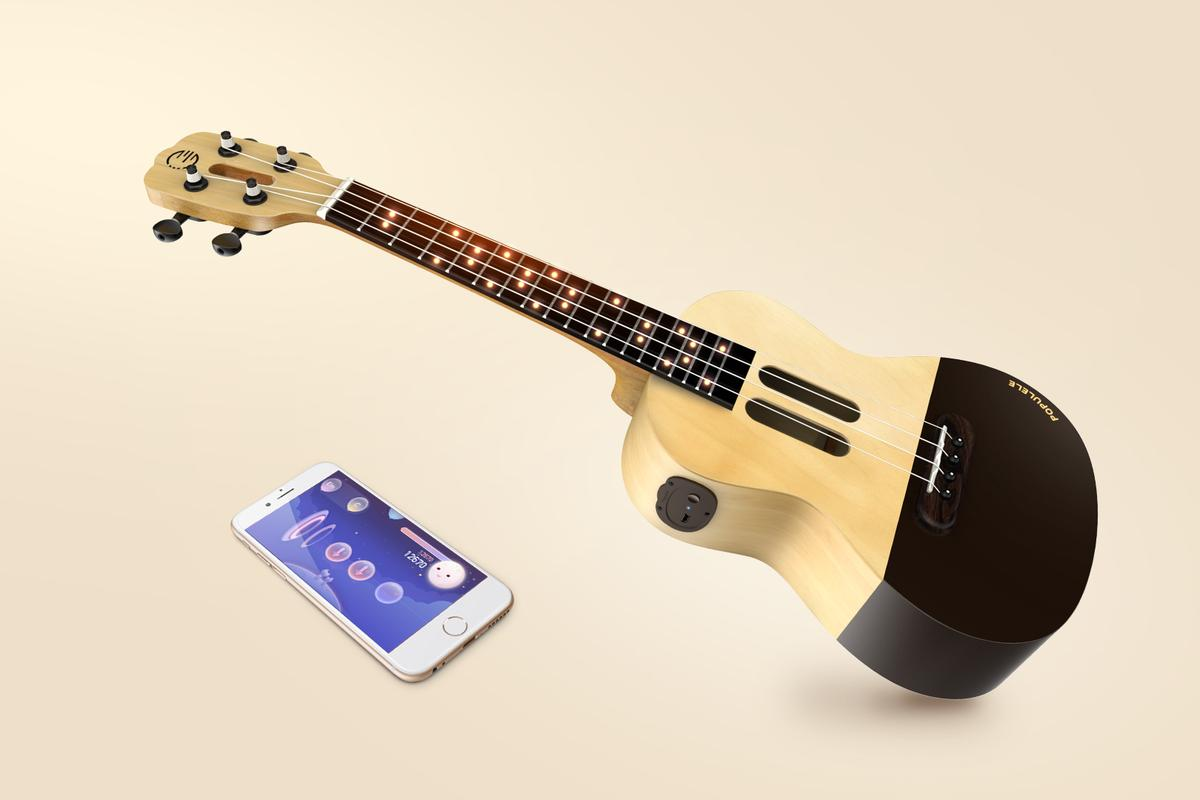 The Populele connects via Bluetooth to a smart device running a learning app, which lights up finger positions on the fretboard to teach chords and songs