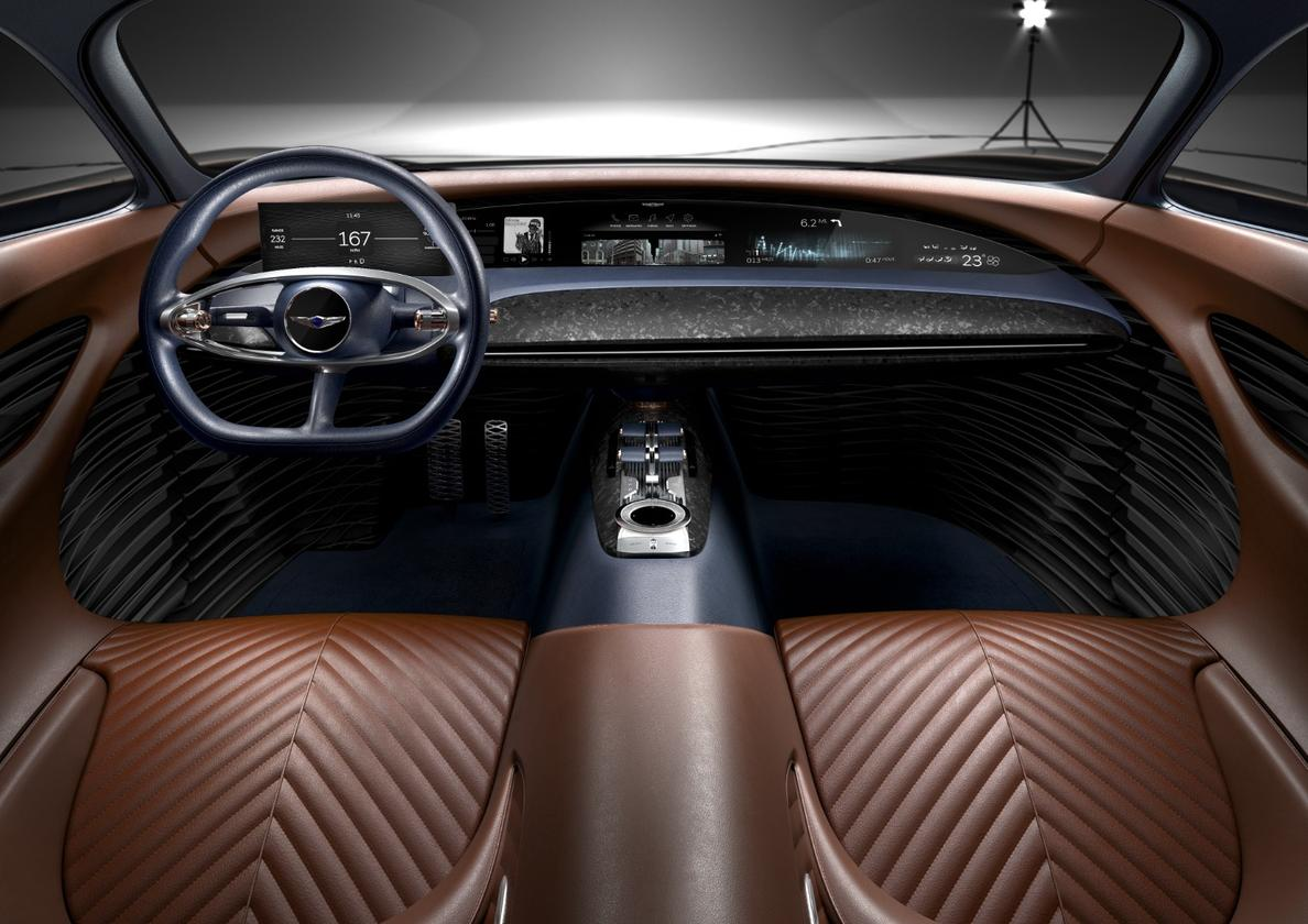 Warm Cognac leather in the Genesis Essentia conceptwraps the front occupants while a full-length digital dash keeps them engaged