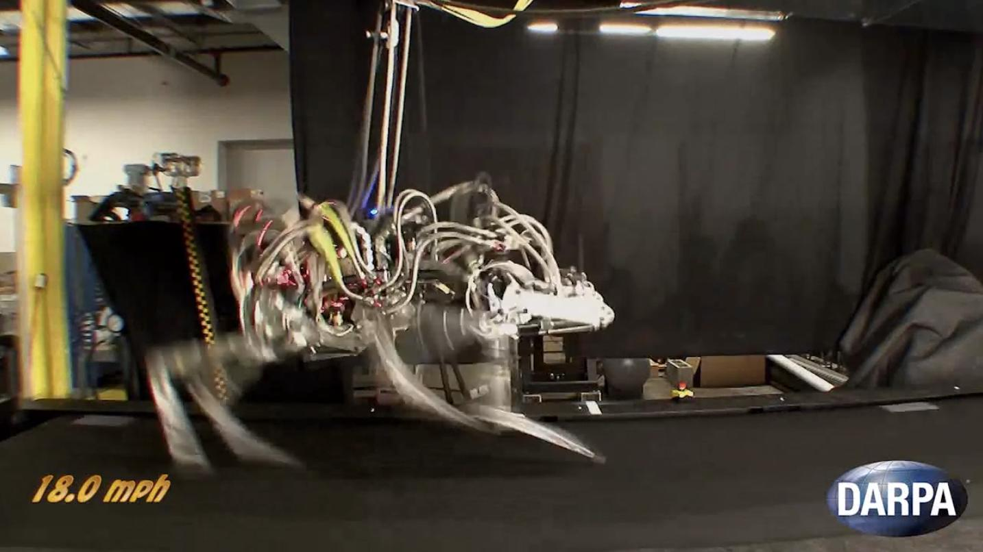 DARPA's quadruped CHEETAH robot has broken the land speed record for legged robots by reaching a gallop of 18 mph on a treadmill