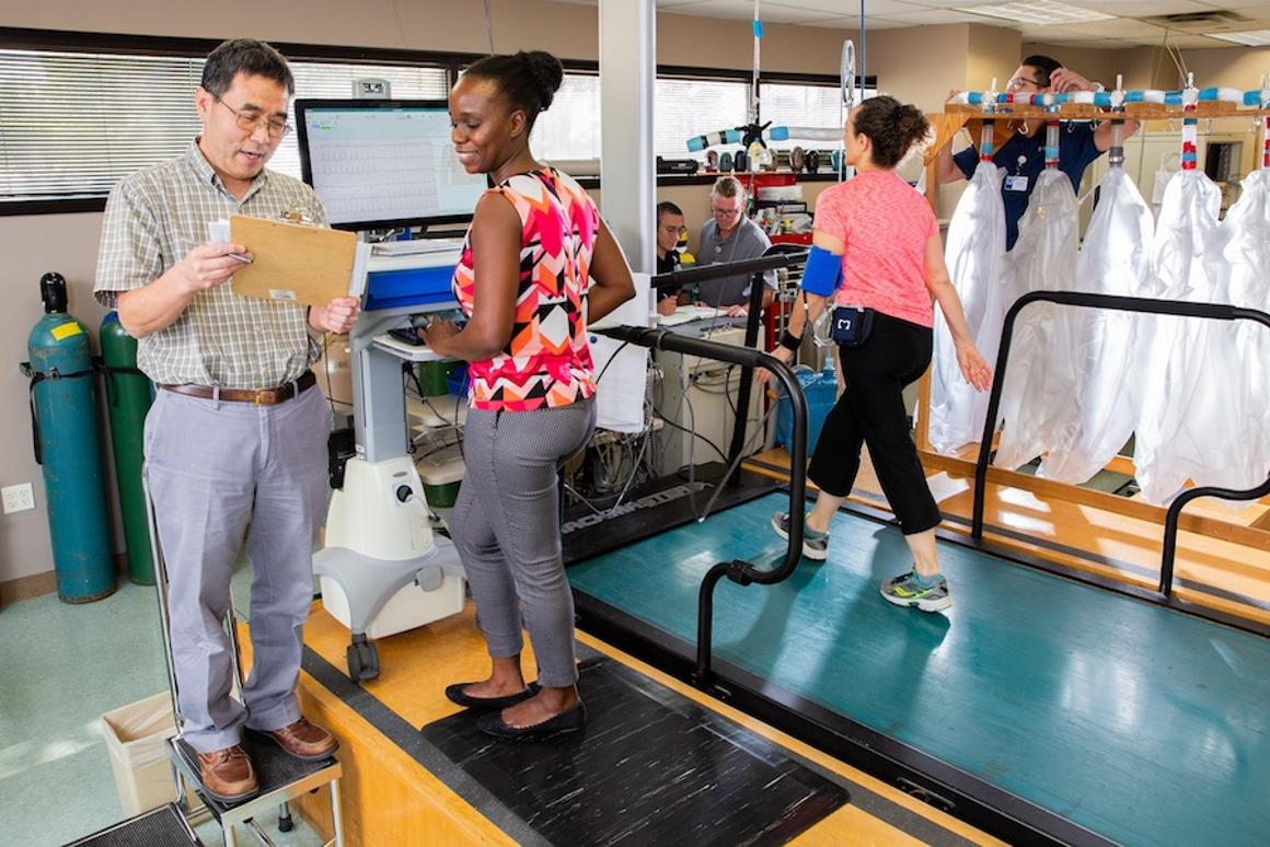 Rong Zhang (left) leading a UT Southwestern study revealing regular aerobic exercise can slow brain degeneration in the hippocampus, linked to Alzheimer's disease