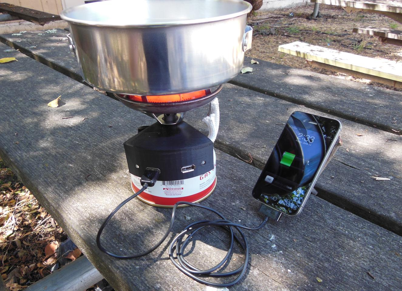 The Halo is a backpacking stove with built-in fuel cell charger for charging mobile devices