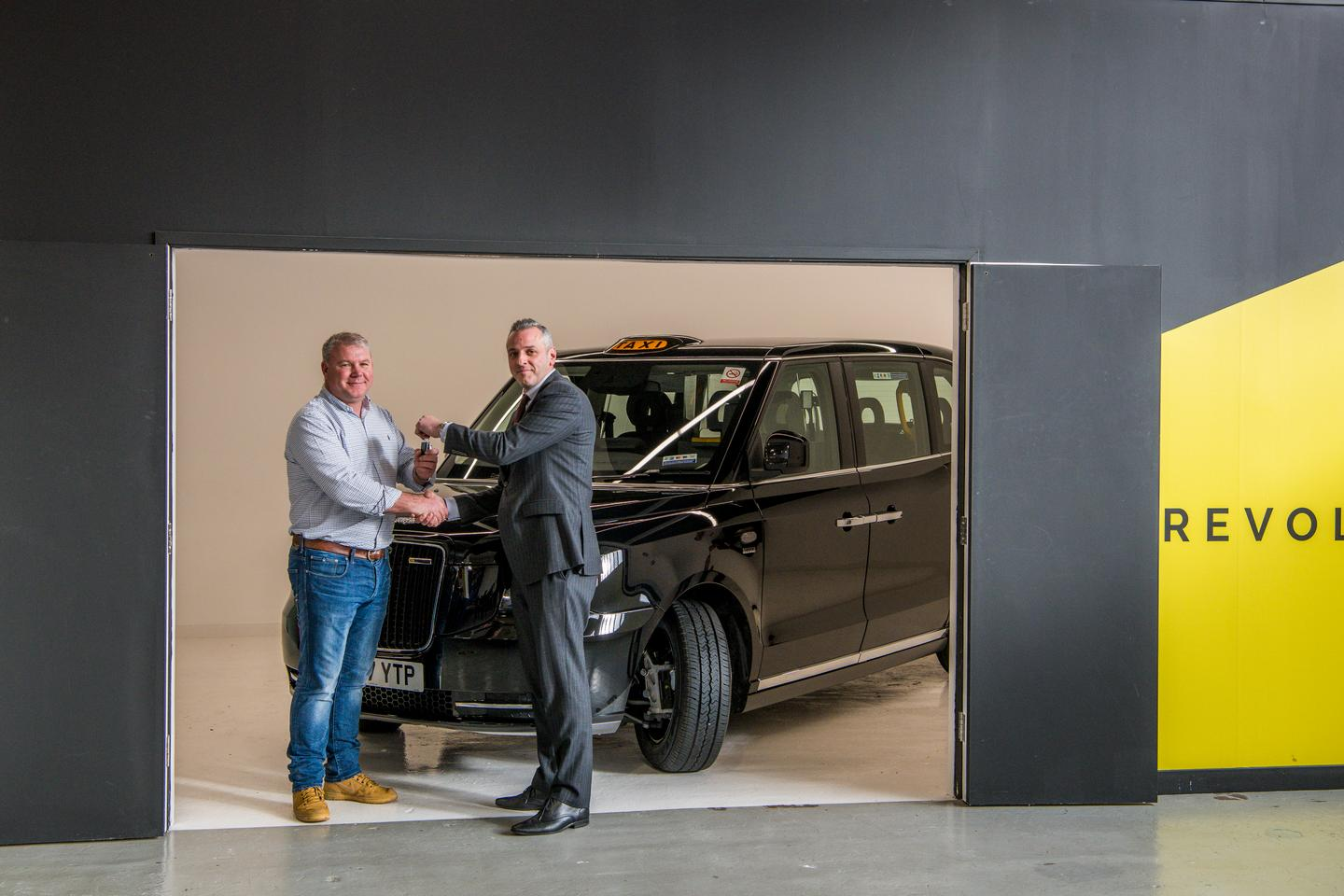 London cabby David Harris gets the keys to his new TX electric taxi from LEDV's Lorenzo Bugliari