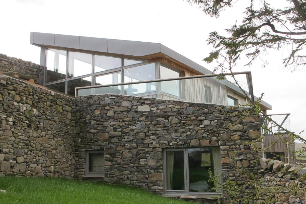 All of the house's external walls have been insulated with wool from the farm (Photo: Mark Waghorn Architects)
