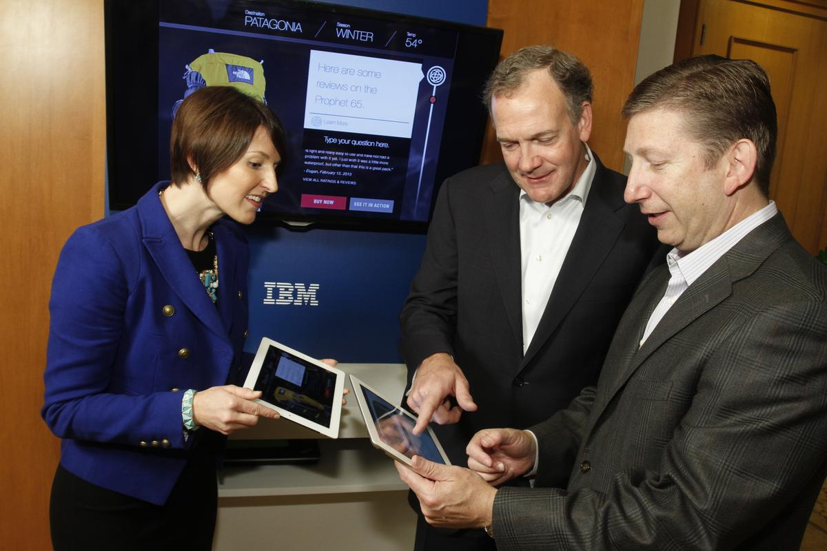 IBM executives explore Watson apps, with a shopping portal powered by Watson in the background (Photo: Jack Plunkett, Feature Photo Service)