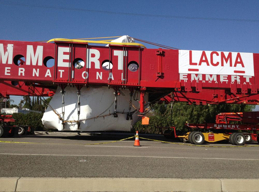 A specially-designed truck is carrying the massive 340-ton rock to Los Angeles at 8mph