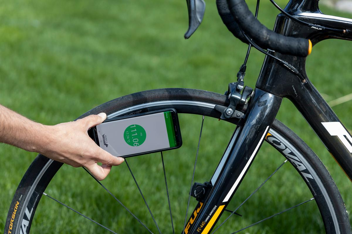 The PSIcle sensor (hidden here by the smartphone) is currently on Kickstarter