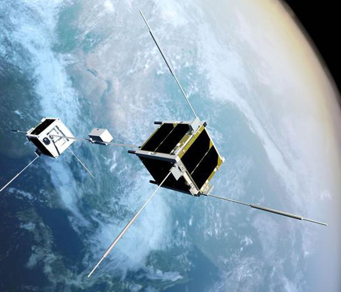 An artist's conception of the STARS-Me satellites, two CubeSats connected by a tether with a robot that climbs between them