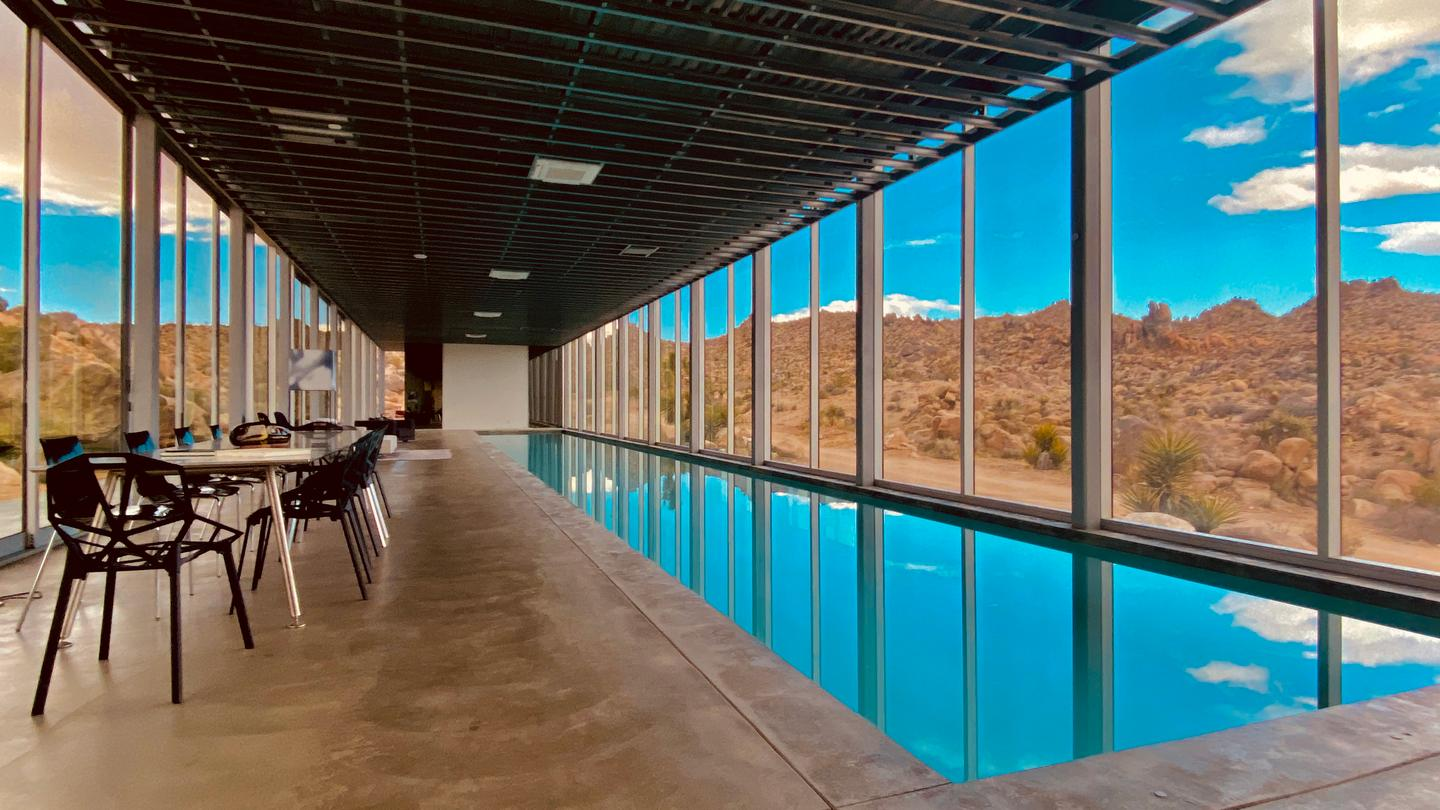 The Invisible House's pool helps keep the interior a comfortable temperature, says architect Tomas Osinski