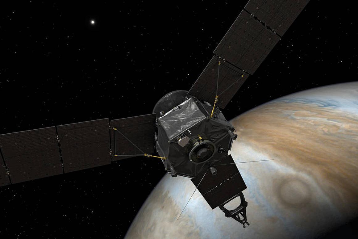 An artist's impression of the Juno probe in orbit around Jupiter