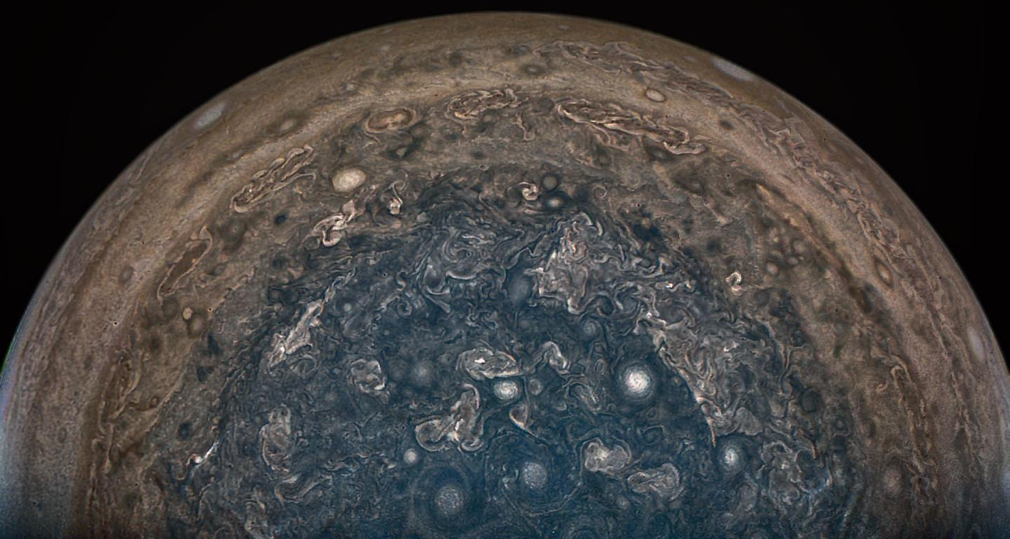 """This image was captured by the """"JunoCam"""" aboard the probe when it passed over Jupiter's south pole on February 2 from a distance of about62,800 mi(101,000 km)"""