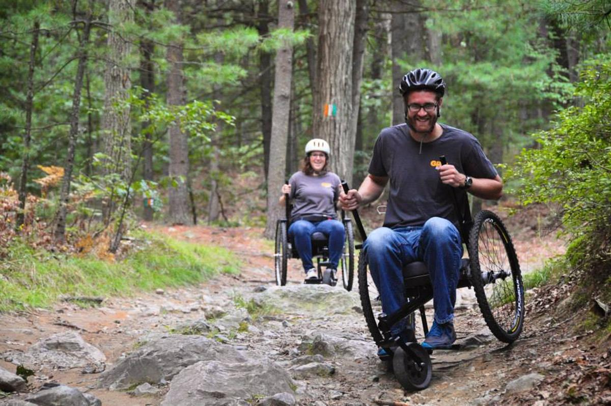 The Freedom Chair's knobby bike tires and torque-increasing lever drive help it navigate rough terrain