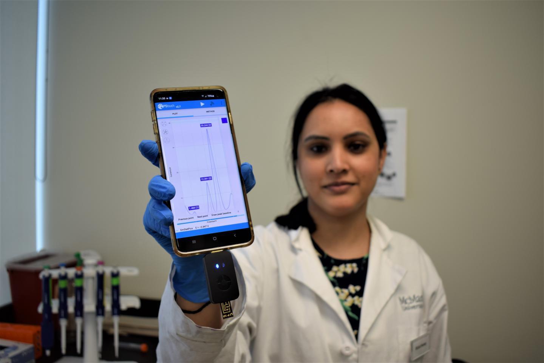 Postdoctoral fellow Richa Pandey, with the bacteria-detecting prototype