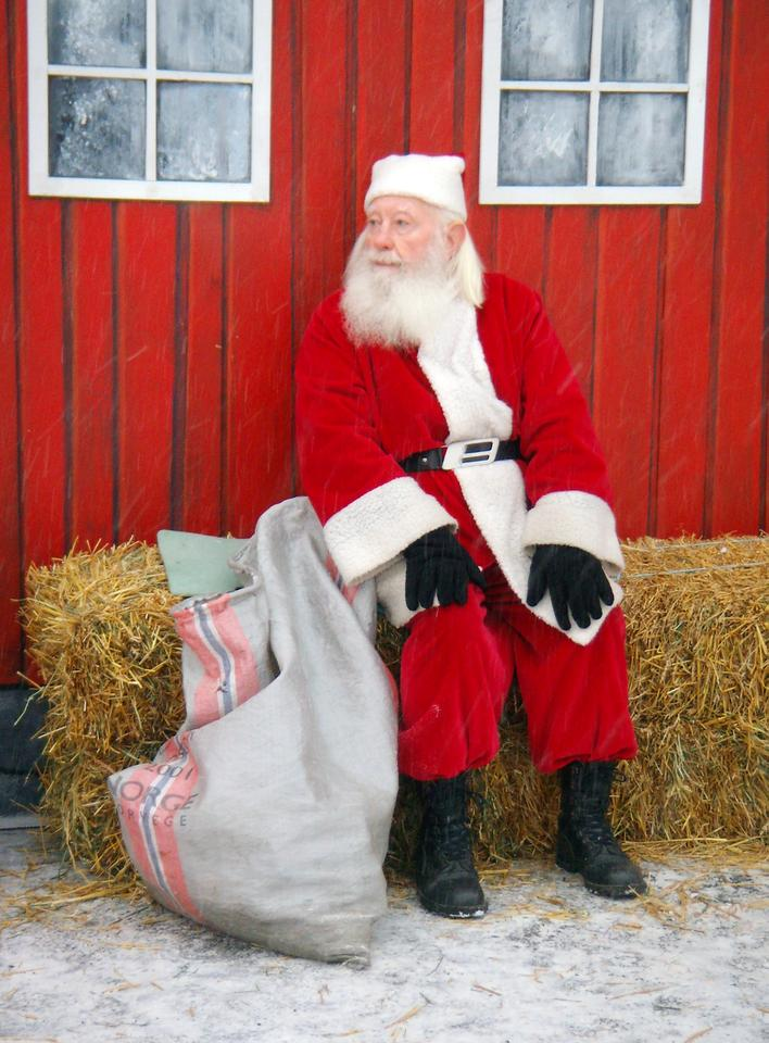 You can call Santa and leave a message, or have him send a personalized call to a loved one (Santa with phone via Shutterstock)