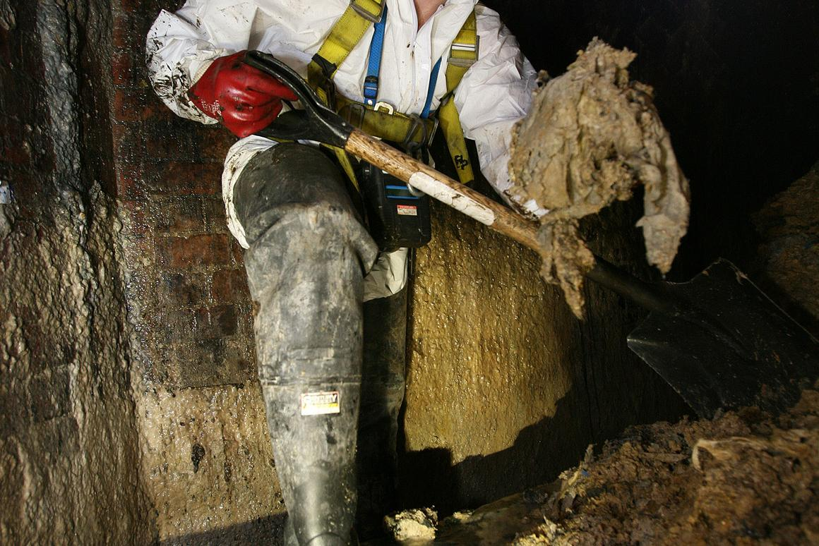 A Thames Water employee clearing fat from beneath London's Leicester Square