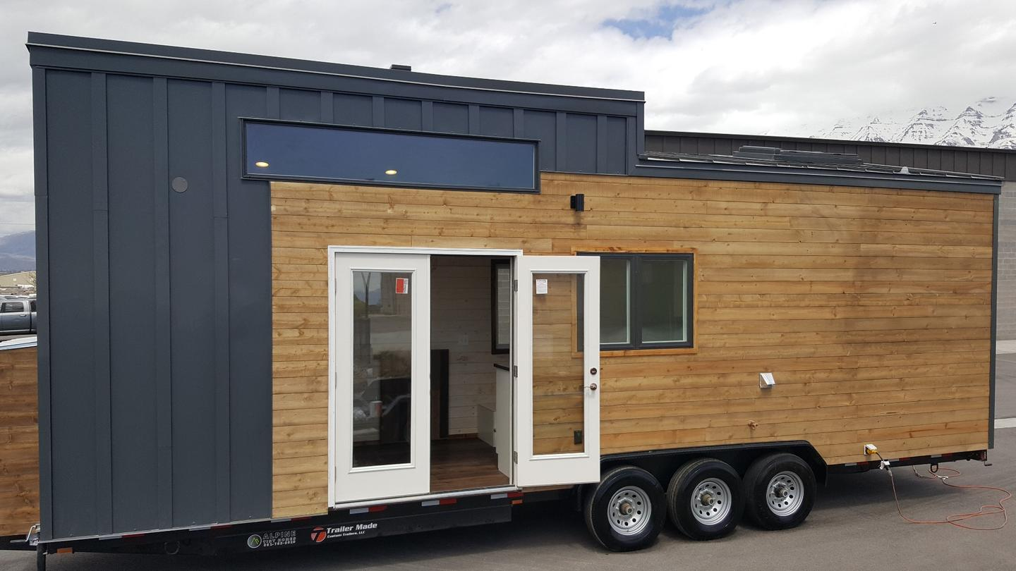 The tiny house measures 30 ft (9 m)-long and is based on a triple-axle trailer