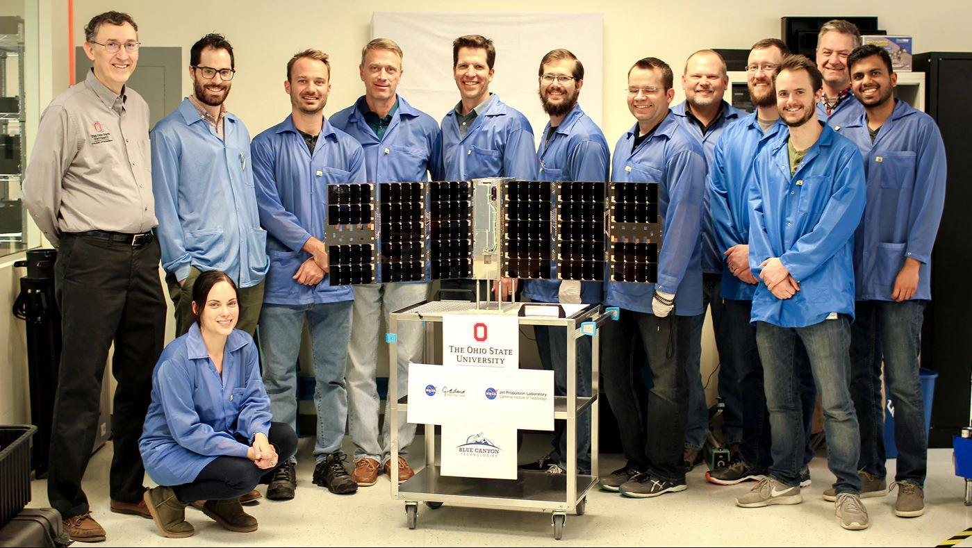 The CubeRRT satellite and Blue Canyon Technologies team members with Principal Investigator Joel Johnson (far left) of The Ohio State University