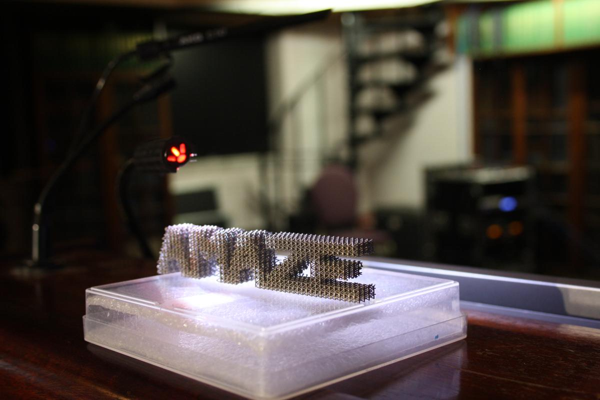 The AMAZE logo printed in metal using an additive manufacturing 3D printing technique that could be making its way to the ISS in the not too distant future (Photo: ESA-N. Vicente)