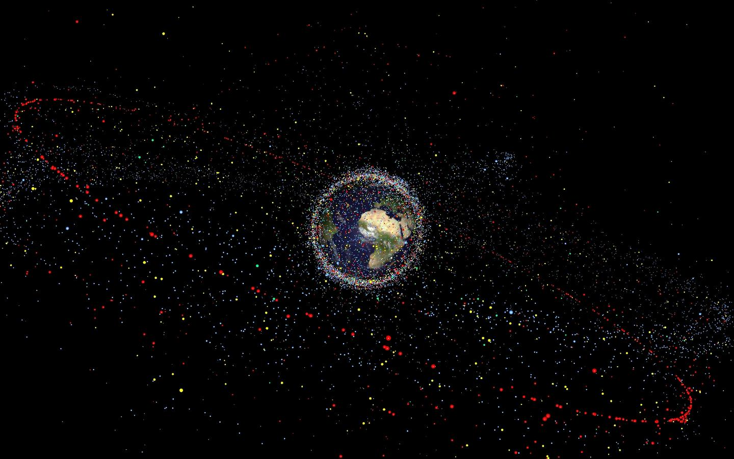Earth is surrounded by a cloud of debris that is becoming increasingly hazardous to operational satellites (Image: ESA)