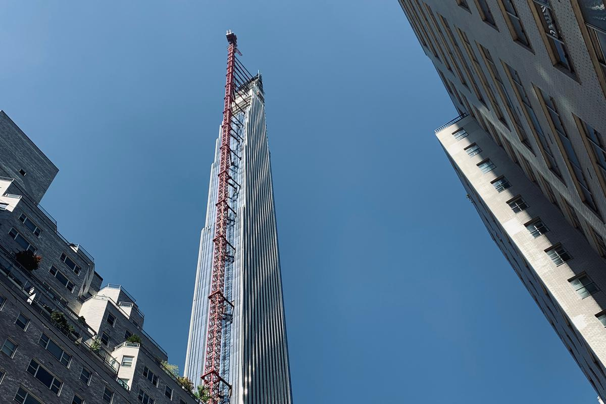 111 West 57th Street rises to a height of 1,428 ft (435 m) in New York City
