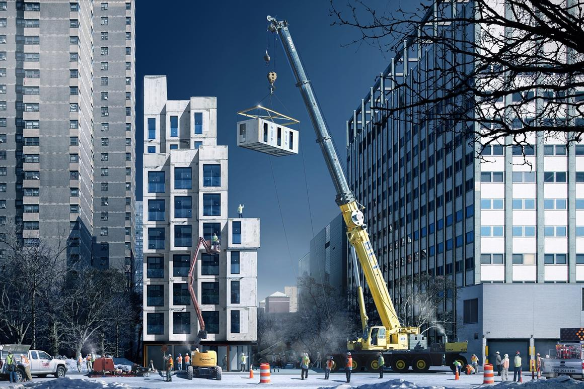The prefabricated modules of My Micro New York are lifted into place individually