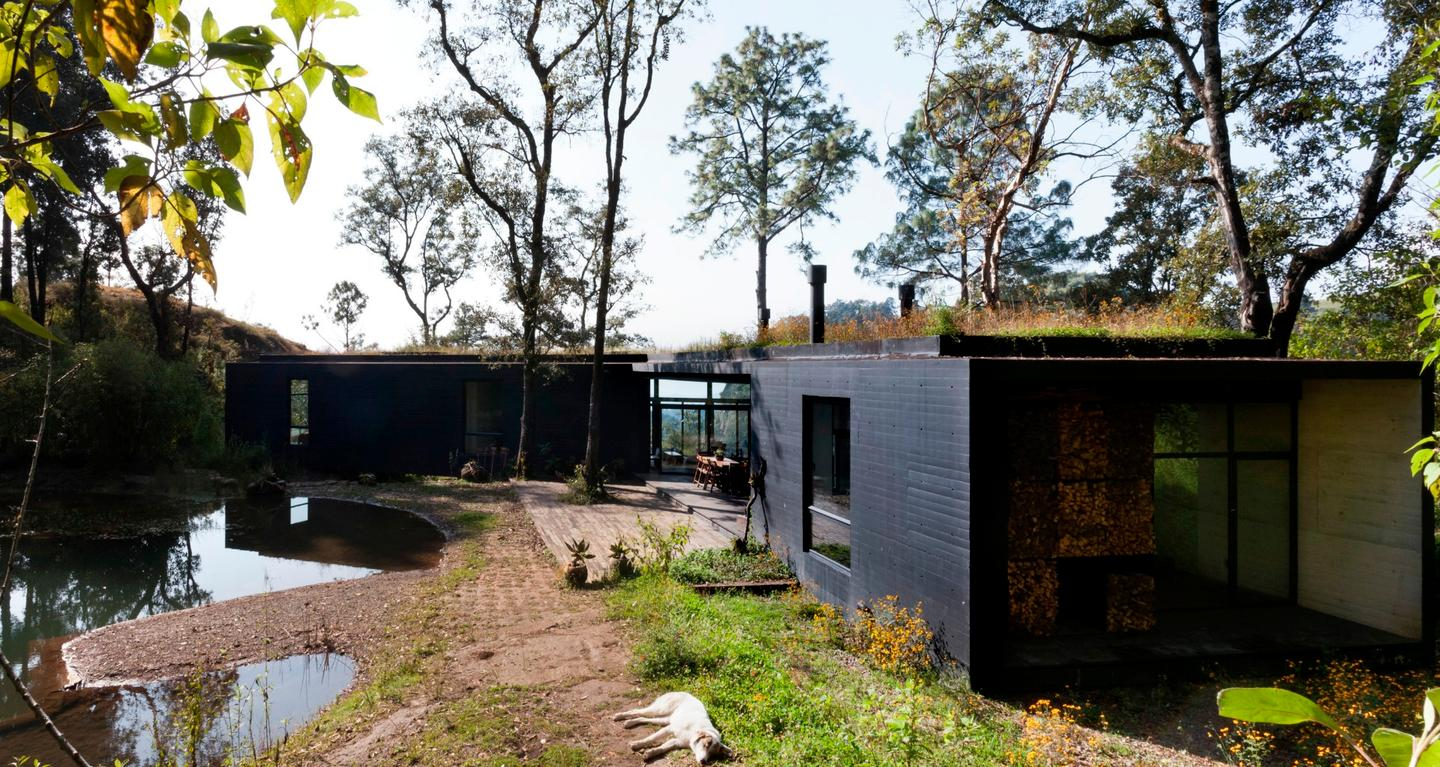Tucked away in the wooded hillside near Mexico's Valle de Bravo, a unique new tripod-shaped home has taken shape