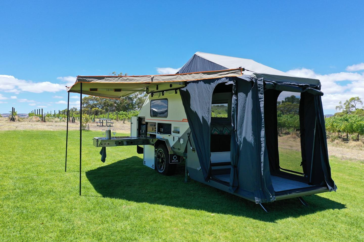 When fully set up, the Offline Domino includes a shaded outdoor kitchen, changing room tent and cozy hard-sided sleeping cabin
