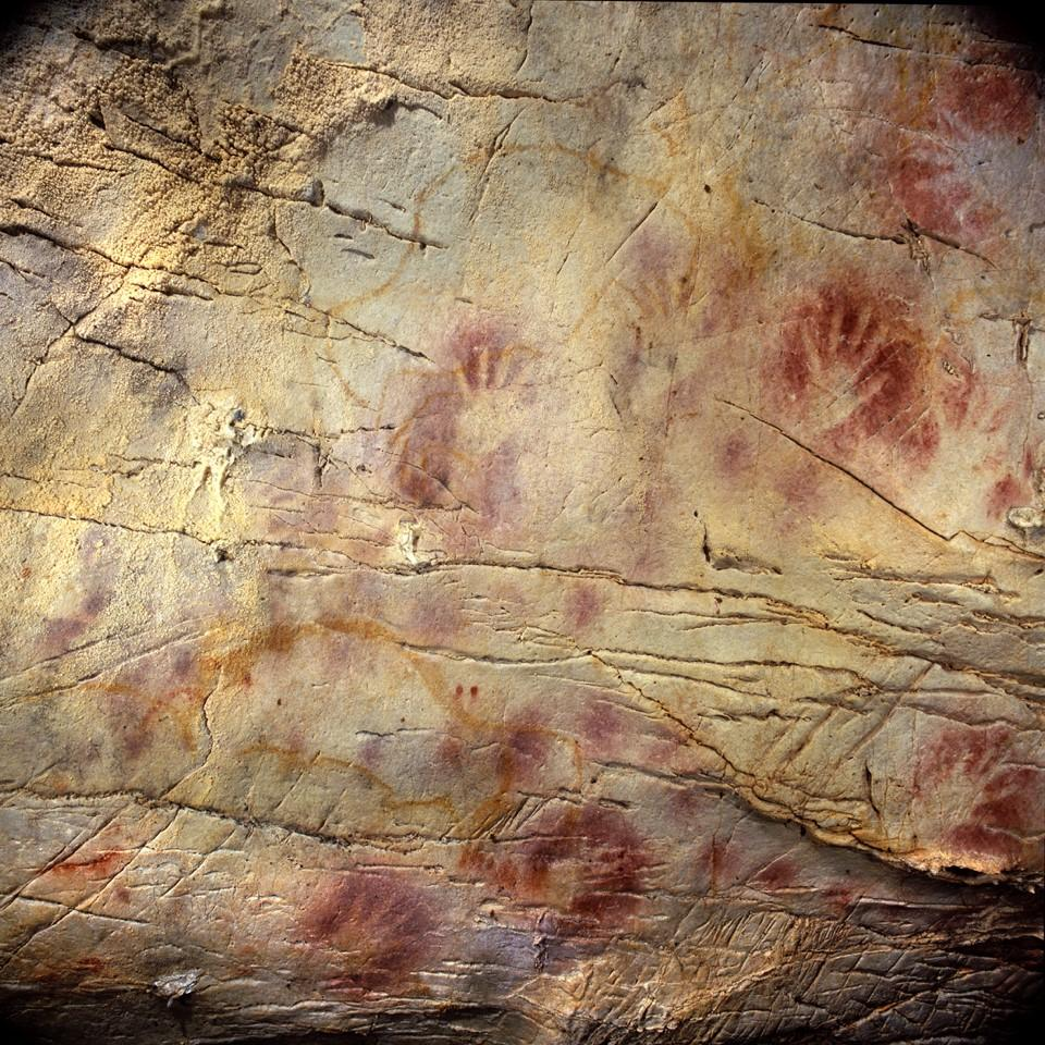Handprints in red ochre – which may have been used as an ancient form of sunscreen – are a common cave art motif. The centre of this cave art from Spain is believed to be almost 42,000 years old.