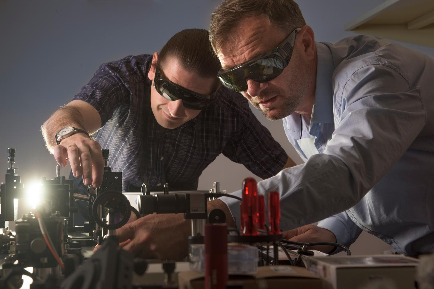 Professor Andrey Miroshnichenko (left) and Dr Vladlen Shvedov (right) in the lab
