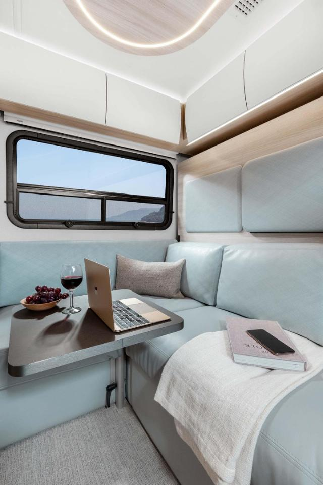 The removable swivel table turns the Leisure TravelVans Unity RLinto a very comfortable remote office; moreover, the safe is designed to lock awaya 17-in laptop