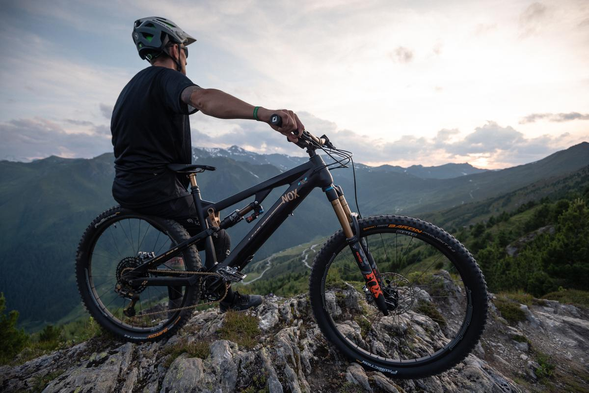Clearly inspired by the Alpine trails surrounding the its factory, Nox e-MTBs are designed to offer motor assistance on the stiff climbs necessary to bomb back down the mountain