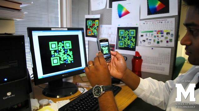 An AutoCAD rendering of one of the QR codes, being read by a smartphone