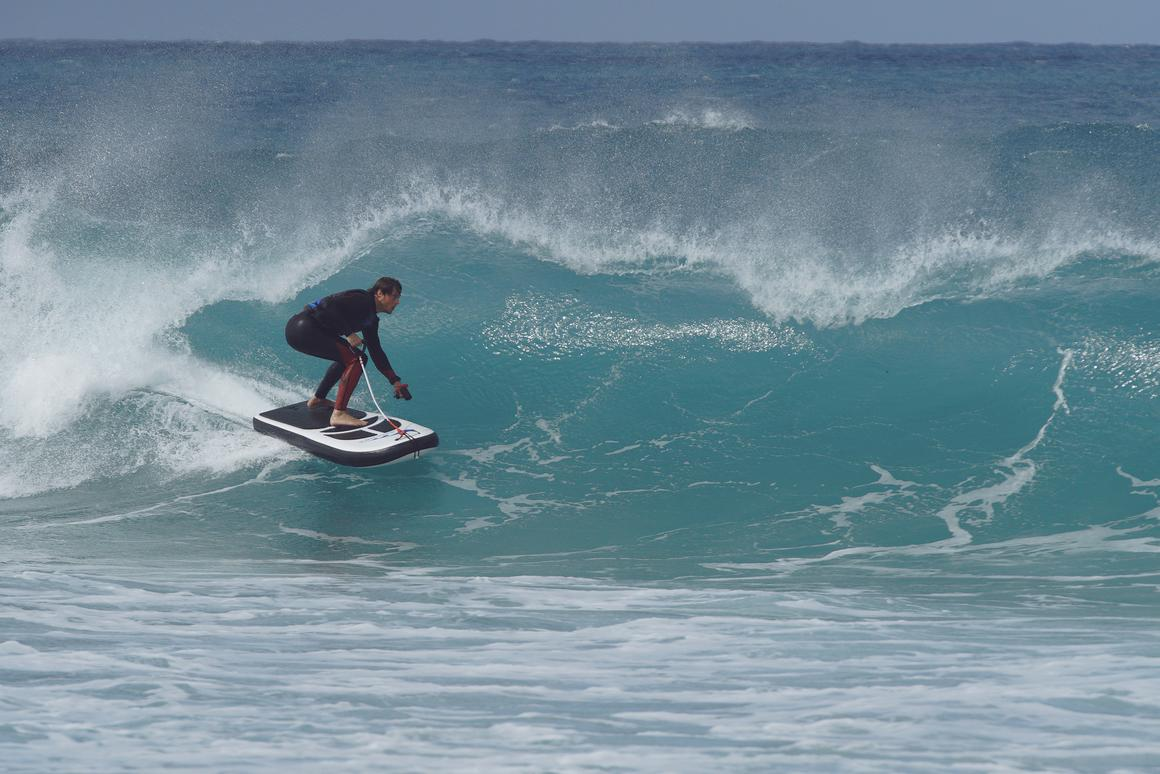 The Lampuga Air can surf without waves, but it also looks pretty fun with them