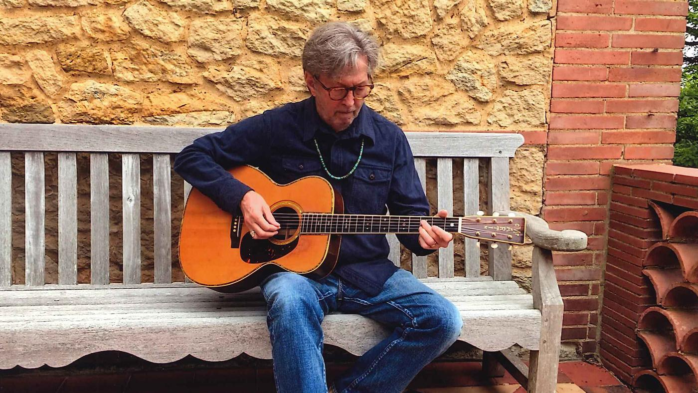 Eric Clapton and the top-priced guitar in the sale, a Martin 000-45