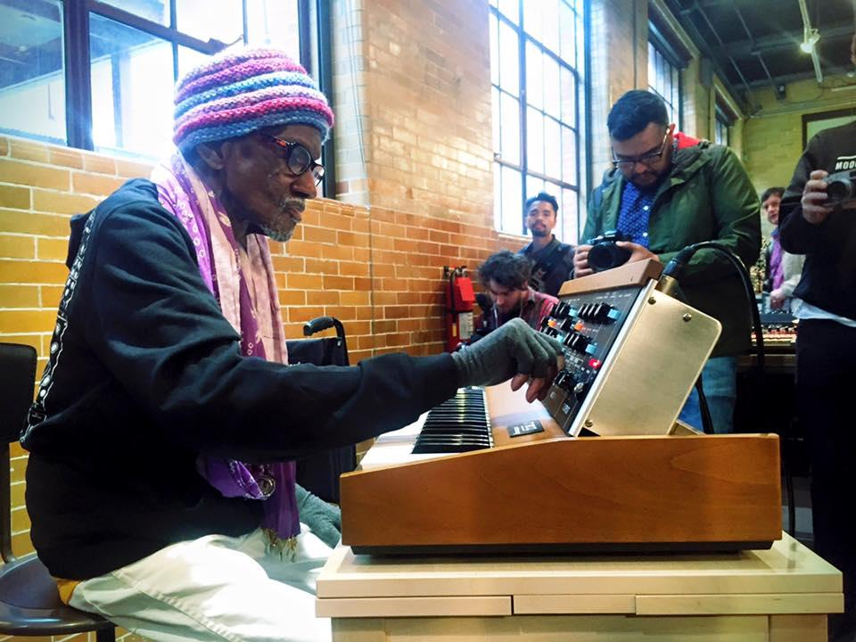 Founding member of Parliament-Funkadelic Bernie Worrell tries a new Minimoog Model D for size at the Moog Pop-Up Factory at Moogfest 2016