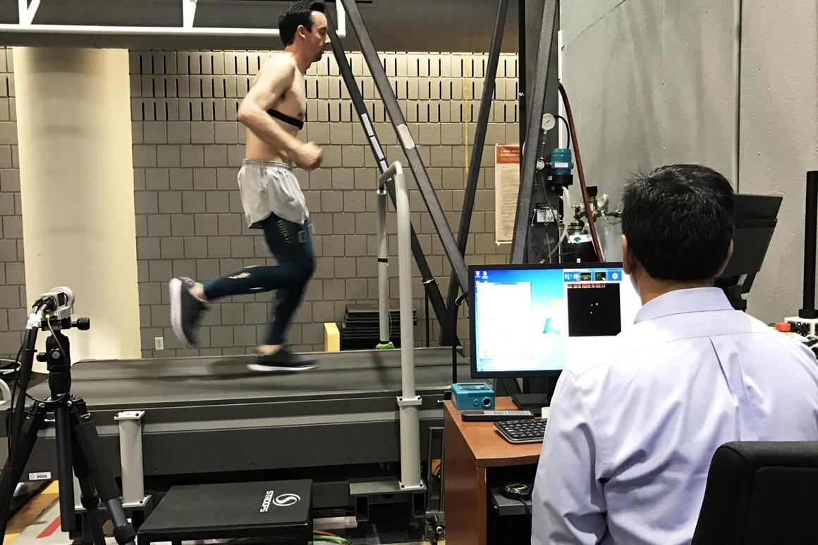 Dr. Ajit Chaudhari observes as one of the test subjects runs while wearing tights