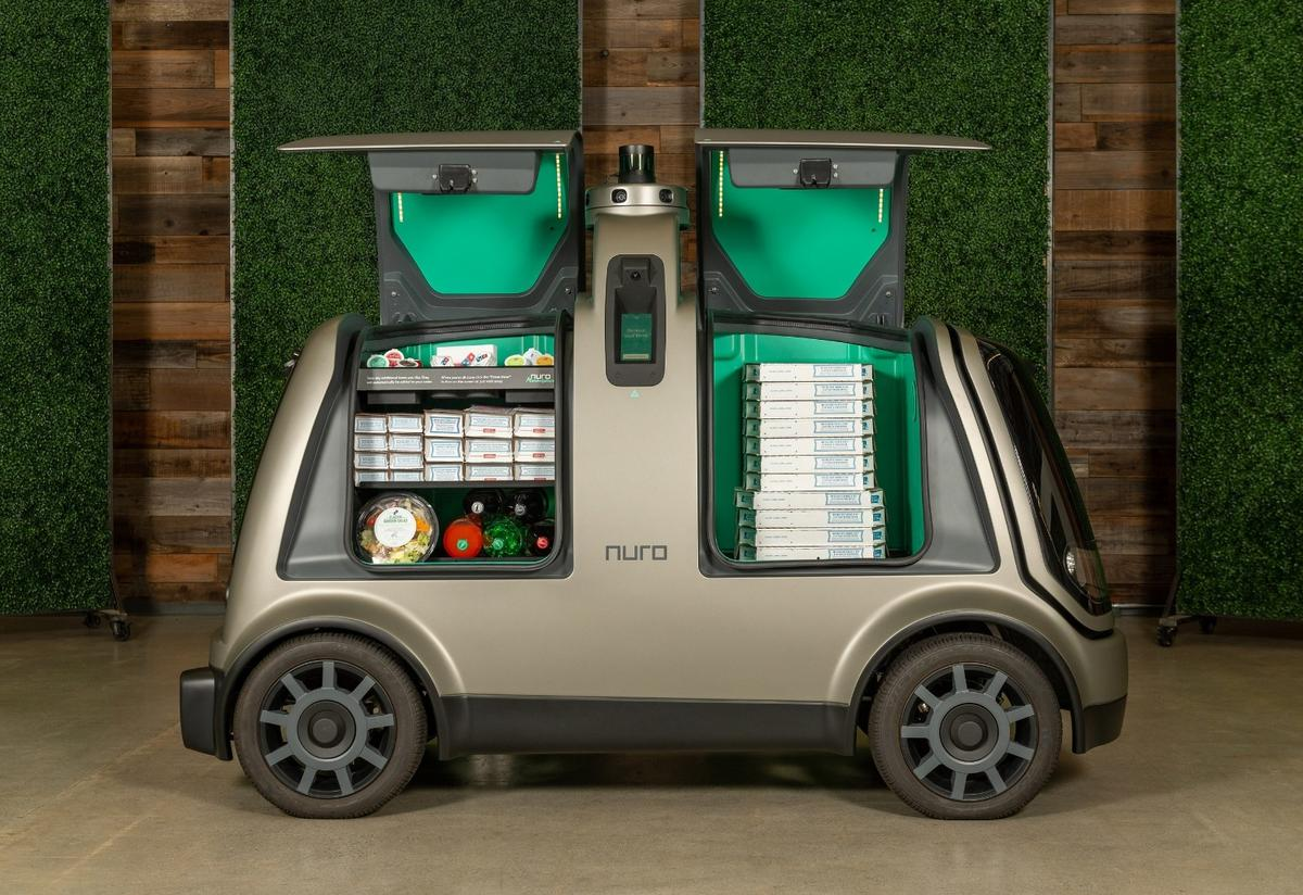 Nuro's self-driving pod called R2 is built to roam the streets with its cargo holds loaded up with food items for hungrycustomers