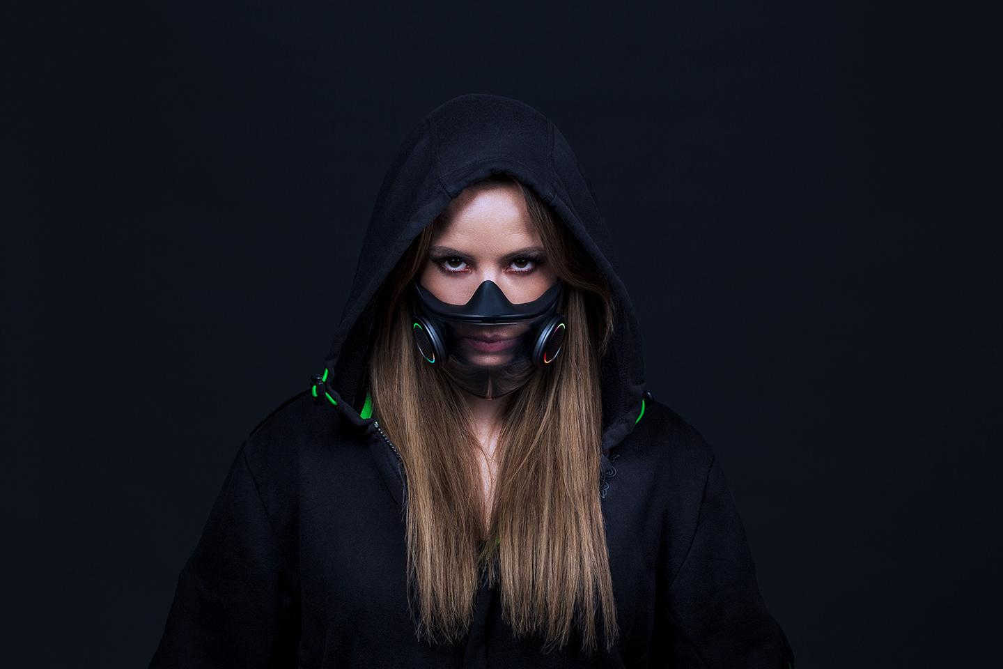 The mask is transparent, allowing the wearer's mouth movements to be visible