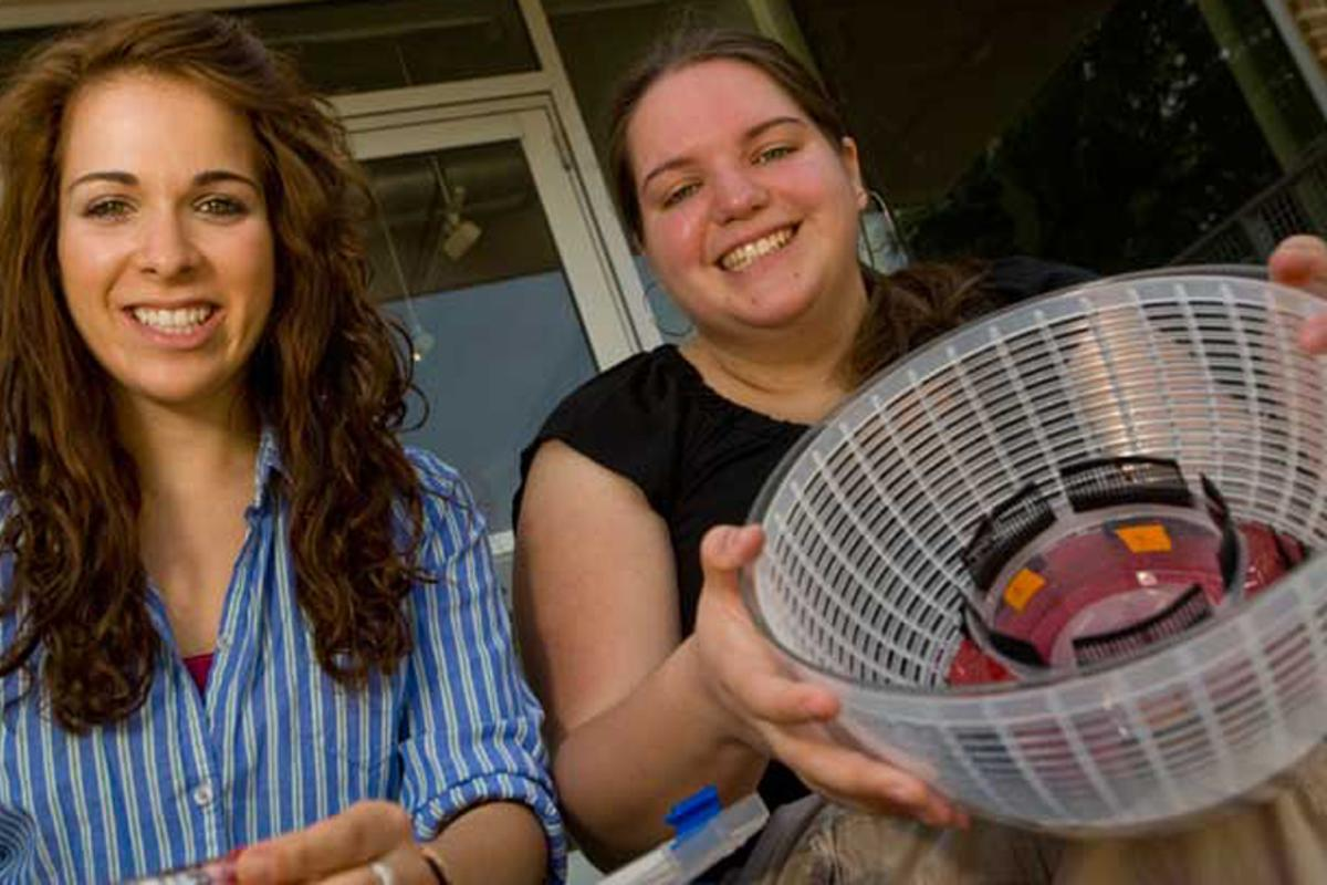 Rice University students Lauren Theis, left, and Lila Kerr with their Sally Centrifuge constructed from a salad spinner
