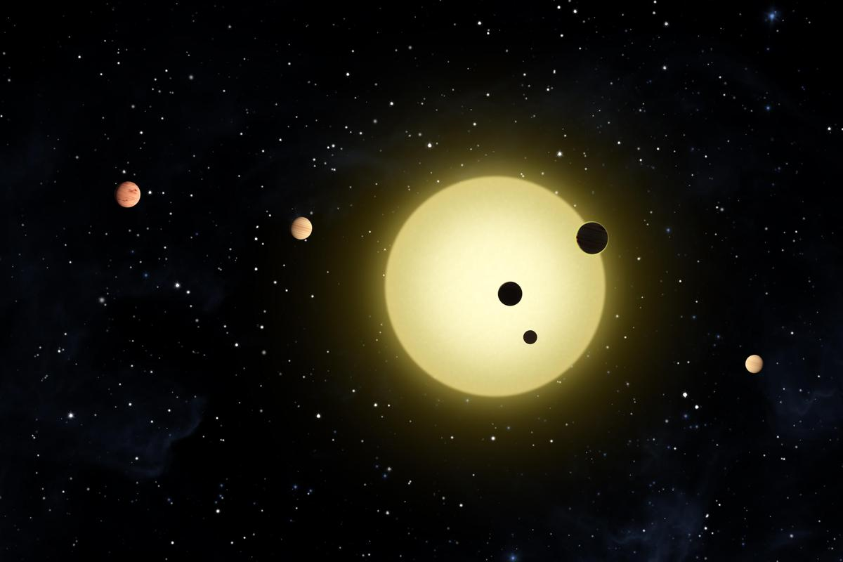 Artist's impression of Kepler-11 planetary system as three planets transit - observed by NASA's Kepler spacecraft on Aug 26 2010 (Credit: NASA - Tim Pyle)