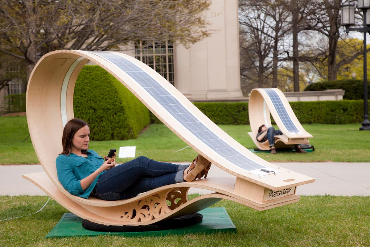 Developed for MIT's Festival of Art Science Technology, the SOFT Rockers use enhanced fabrication techniques to curve flat wooden panels, and have solar panels installed to charge the gadgets of those who relax within (All images courtesy of Phil Seaton)