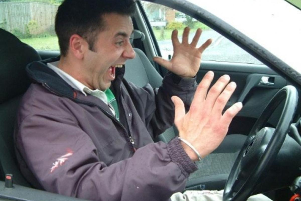 This man appears to be annoyed by interior buzzing sounds in his car. We suggest he gets a Rattlebuster post-haste.