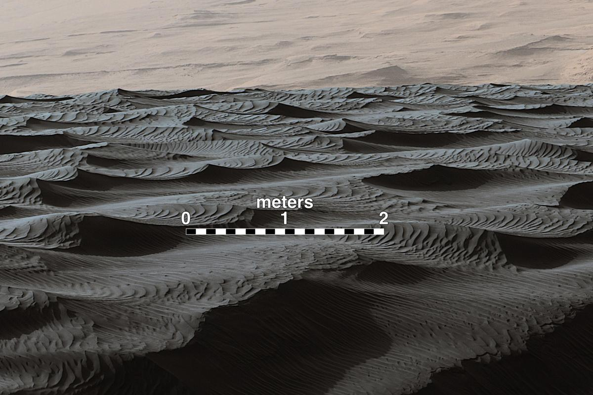 Two sizes of wind-sculpted ripples on Mars sand dune: the larger ripples are roughly three meters apart and of a type not seen on Earth