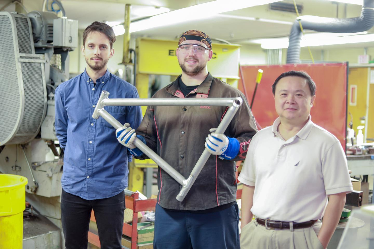 Grad student Maximilian Sokoluk (left),  laboratory mechanician Travis Widick and Prof. Xiaochun Li, with a prototype welded AA7075 bicycle frame