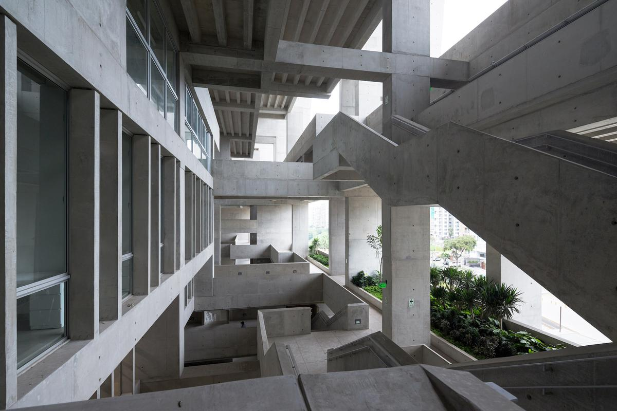University Campus UTEC Lima's criss-crossing forms create shaded nooks for students to relax