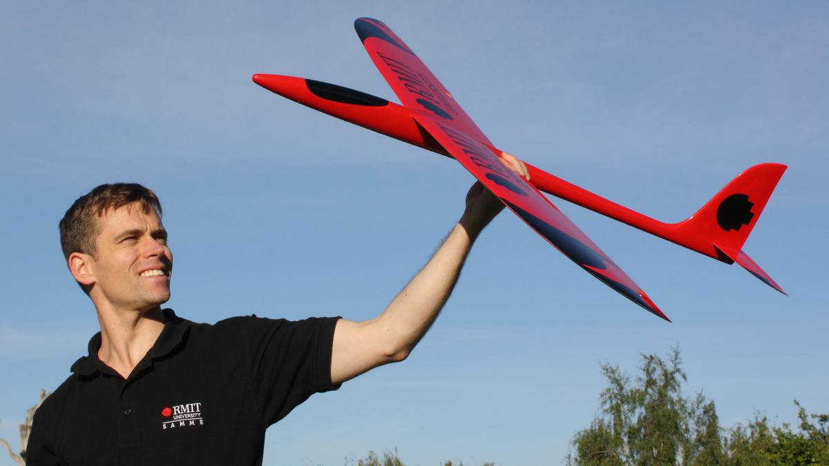 Dr Reece Clothier with a prototype of a bio-inspired unmanned aircraft, under development at RMIT